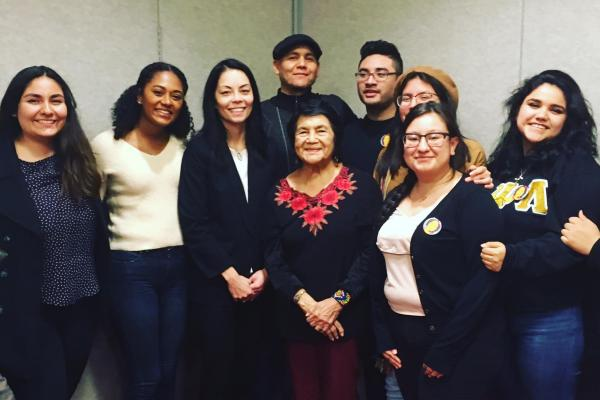 Photo of scholars, activists, and students with Dolores Huerta