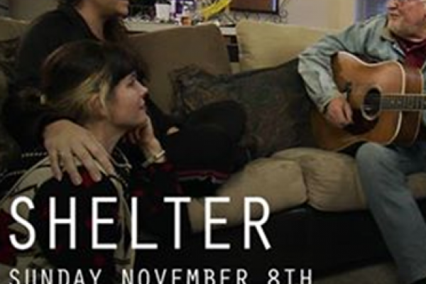 "Photo of two people facing a man with a guitar with the words ""Shelter, Sunday November 8th, 10pm EST/7 pm PST"